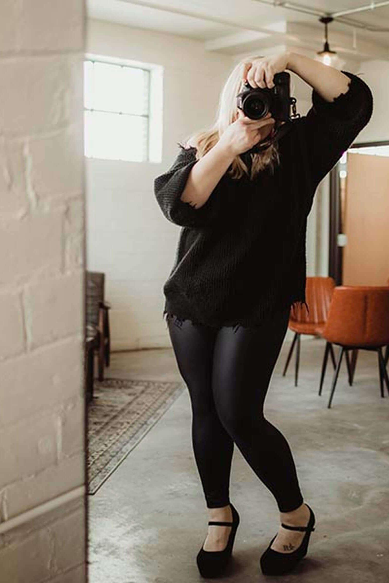 Kim Andera taking photo in mirror at wedding shoot
